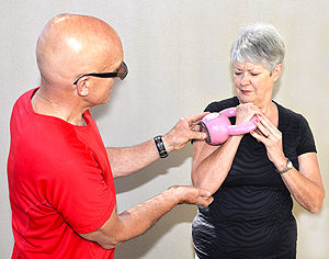 Martin and a client doing kettle bell training